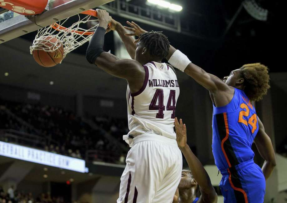 Texas A&M forward Robert Williams (44) dunks the ball as Florida guard Deaundrae Ballard (24) defends during the first half of an NCAA college basketball game Tuesday, Jan. 2, 2018, in College Station, Texas. (AP Photo/Sam Craft) Photo: Sam Craft, FRE / Associated Press / AP