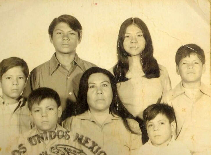 A family photo of Hector de Leon with his mother and some of his siblings from an old passport. From left, Francisco Javier de León (nicknamed Javo), Hector de León (Toro), José Raúl de León (Pepe), María Feliciana de León (his mother Chanita), María Guadalupe de León (Pina), Jorge Humberto de León (Beto) and Luis Arturo de León (Louie).