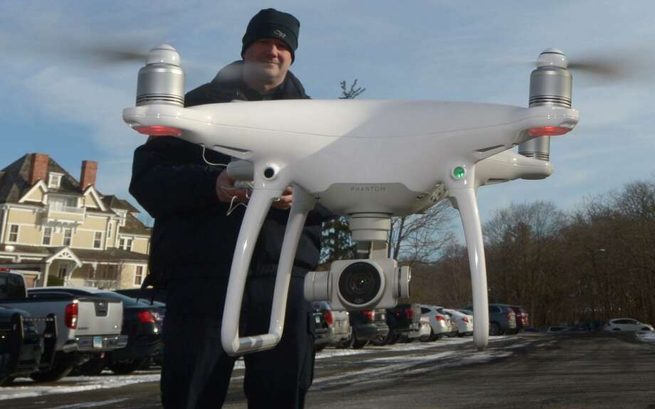Westport Police Captain Ryan Paulsson deploys the department's drone for a demonstration Wednesday , at police headquarters in Westport . Photo: Erik Trautmann / Hearst Connecticut Media / Norwalk Hour