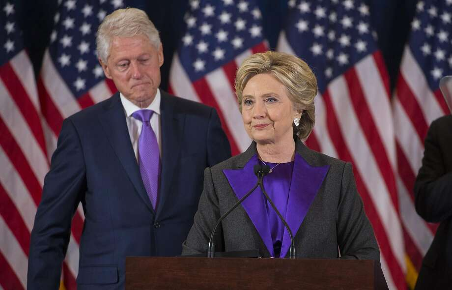Hillary Clinton, accompanied by her husband, former President Bill Clinton, concedes the presidential election to Donald Trump in New York in this Nov. 9, 2016 file photo. FBI agents have renewed asking questions about the dealings of the Clinton Foundation amid calls from President Trump and top Republicans for the Justice Department to take a fresh look at politically charged accusations of corruption. (Ruth Fremson/The New York Times) Photo: RUTH FREMSON, NYT