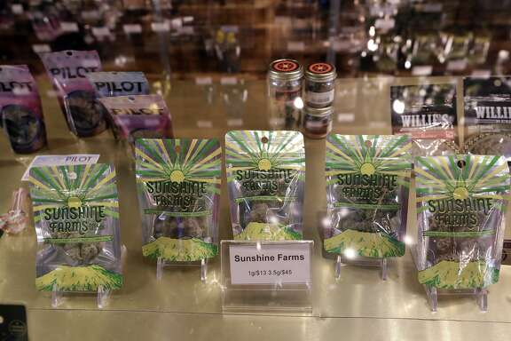 Marijuana products fill a display cabinet in the Herban Legends pot shop, Thursday, Jan. 4, 2018, in Seattle. Attorney General Jeff Sessions has rescinded an Obama-era policy that paved the way for legalized marijuana to flourish in states across the country, creating new confusion about enforcement and use just three days after a new legalization law went into effect in California. (AP Photo/Elaine Thompson)
