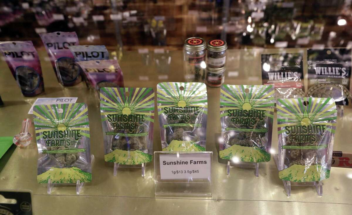 Marijuana products fill a display cabinet in the Herban Legends pot shop, Thursday, Jan. 4, 2018, in Seattle. Attorney General Jeff Sessions has rescinded an Obama-era policy that paved the way for legalized marijuana to flourish in states across the country, creating new confusion about enforcement and use just three days after a new legalization law went into effect in California.
