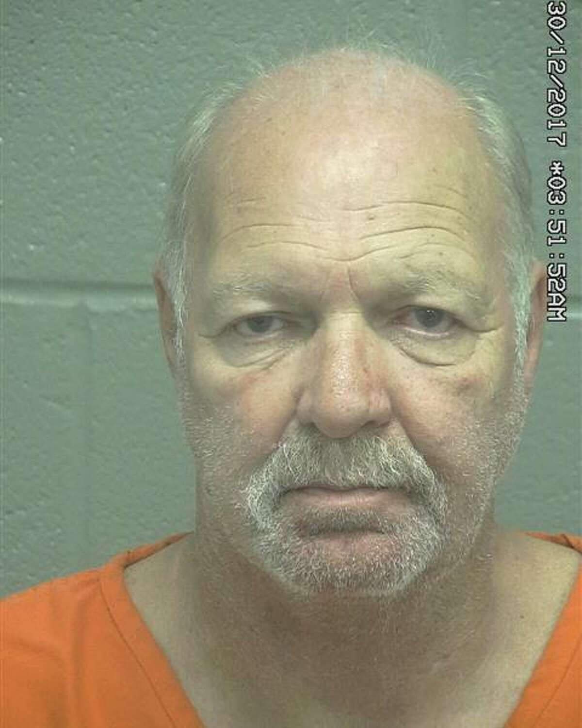 Michael Frank Bell, 61,was arrested Dec. 30 after allegedly pointing a gun during the commission of an assault, according to court documents.