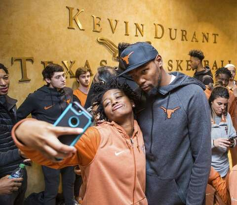 ec1df8402d6 University of Texas women s basketball player Jordan Hosey poses for a  selfie with Kevin Durant following