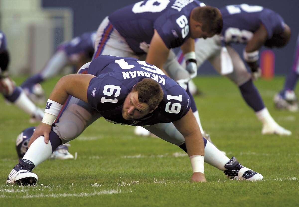 East Rutherford, NJ 16 Aug 2001 - Giants football Scott Kiernan streches out before the Thursday exhibition game agains the Jaguars at Giants Stadium . (Photo Douglas Healey for Greenwich Time).