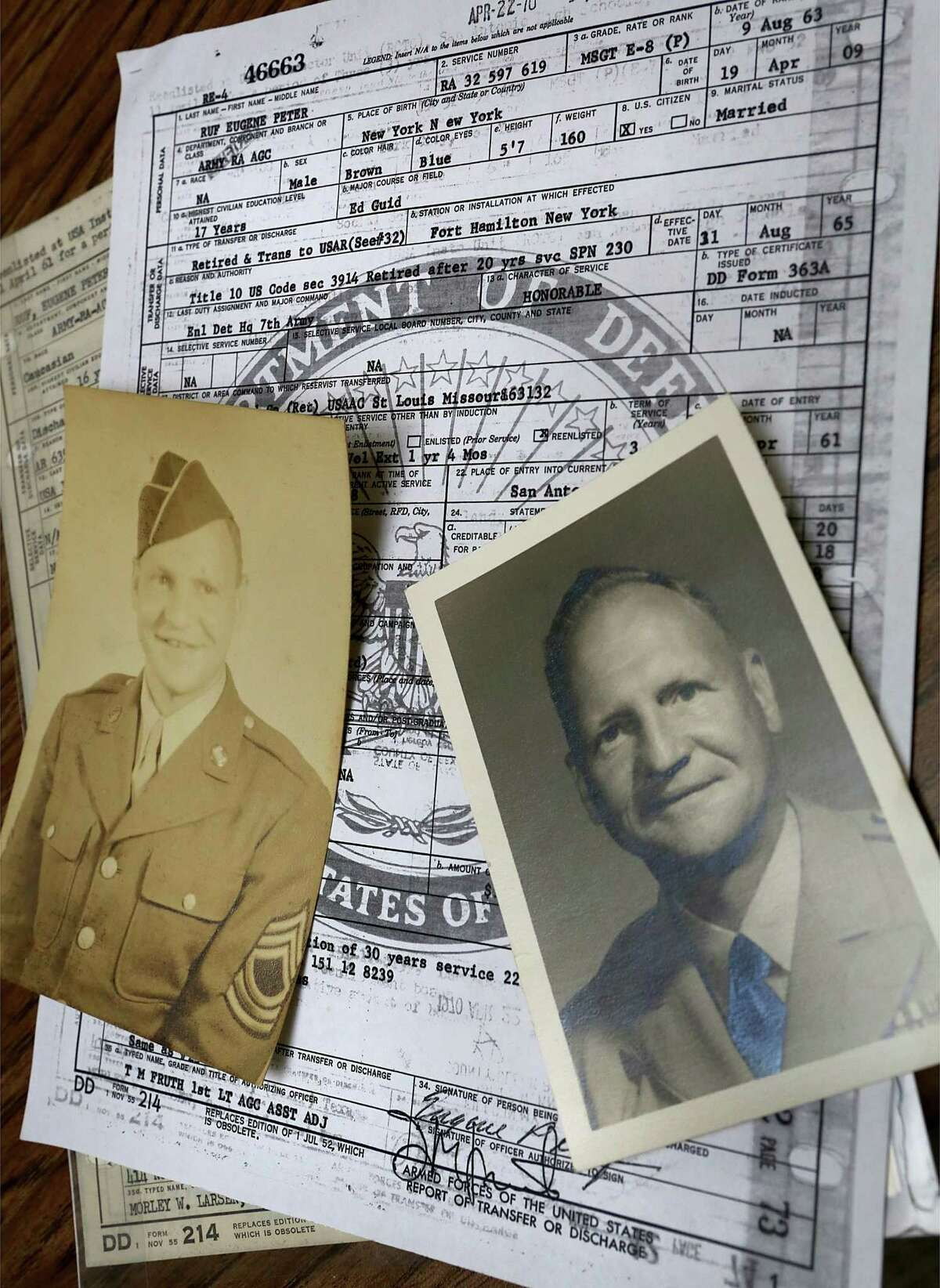 LEFT: Old photos and military discharge papers of Eugene Ruf, a veteran of World War II, who celebrated his 108th birthday on Wednesday, April 19, 2017, at Brookdale Senior Living Solutions with family and friends.