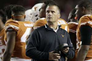 AUSTIN, TX - NOVEMBER 24: Defensive coordinator  Todd    Orlando  of the Texas Longhorns looks toward the scoreboard during a timeout in the second half against the Texas Tech Red Raiders at Darrell K Royal-Texas Memorial Stadium on November 24, 2017 in Austin, Texas.
