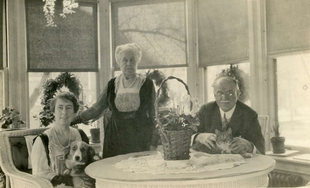 Pets have a long history in the Hotchkiss-Fyler House, now the home of the Torrington Historical Society. From left: Gertrude Fyler Hotchkiss, Mary Fyler, and Edward Hotchkiss, along with their dog and cat, in a photo taken circa 1930.