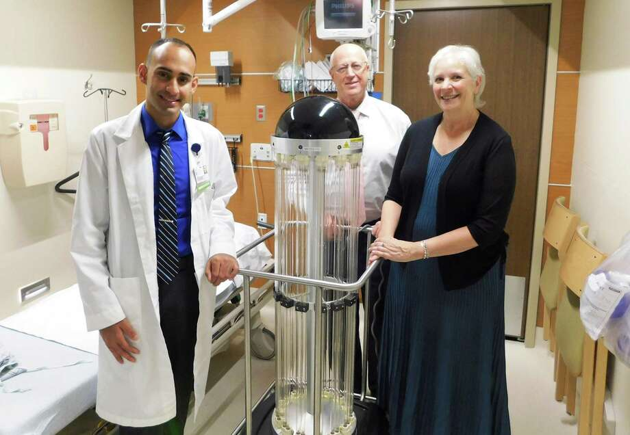 Paul Gentile, CHH Infection Control and Prevention Coordinator, reviews Charlotte Hungerford Hospital's new Germ-Killing Tru-D Smart Robot with Dan McIntyre, CHH President and Executive Director, center, and Julia H. Scharnberg, Grants and Program Director, Northwest Connecticut Community Foundation, right. Photo: Contributed  Photo