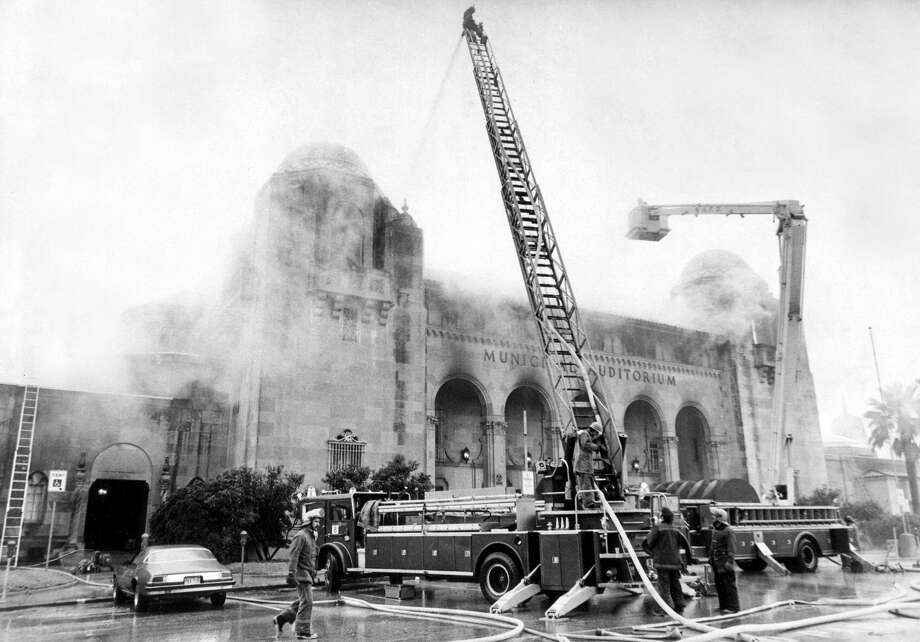 San Antonio firefighters try to contain a four-alarm fire at Municipal Auditorium on Jan. 6, 1979. The auditorium opened more than six years later, after a $13 million renovation and modernization effort. Photo: File Photo / Express-News / SAN ANTONIO EXPRESS-NEWS