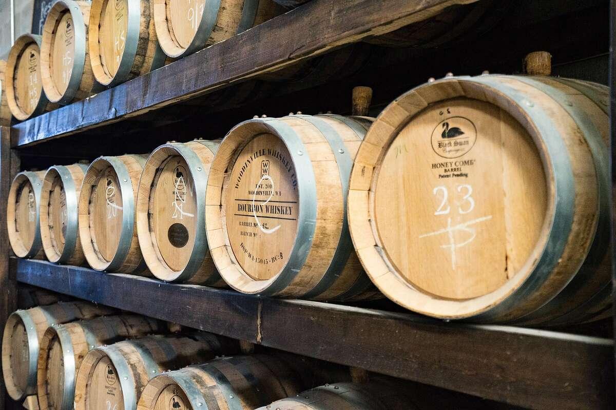 Bottles and barrels at de Vine Spirits, a craft distillery on Vancouver Island near Victoria.