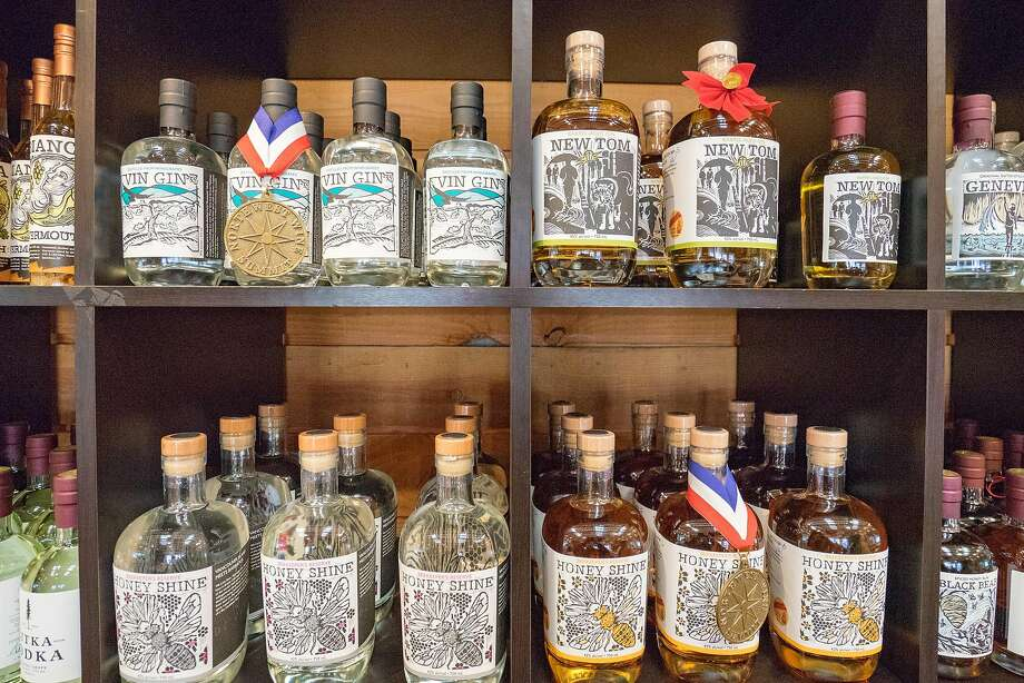 Bottles and barrels at de Vine Spirits, a craft distillery on Vancouver Island near Victoria. Photo: Nancy Besharah, Special To The Chronicle