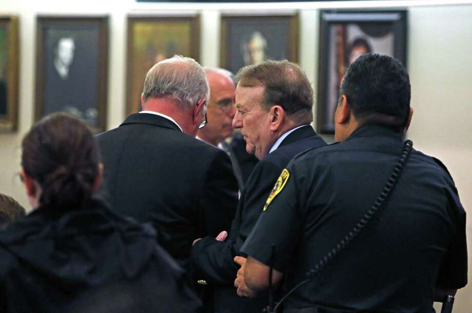 John Campbell is led out of the courtroom after his sentencing Friday. He received 10 years on six counts of promotion of child pornography and eight years on 42 counts of possession of child pornography. The sentences will be served at the same time, and Campbell will be eligible for parole after he has served a quarter of his sentence. Photo: Ronald Cortes /San Antonio Express-News / 2017 Ronald Cortes