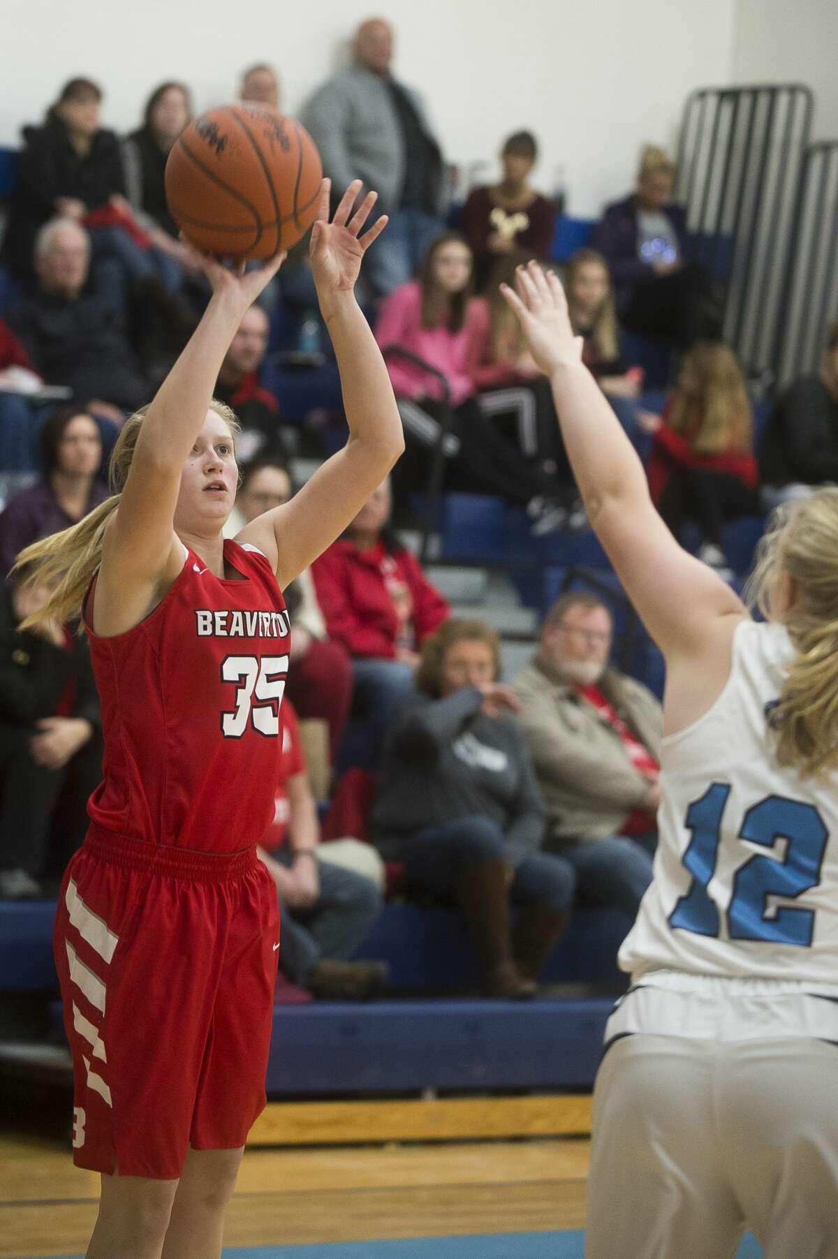 Beaverton senior Maddy Krauss takes a shot during the Beavers' game against Meridian on Friday, Jan. 5, 2018 at Meridian High School. (Katy Kildee/kkildee@mdn.net)