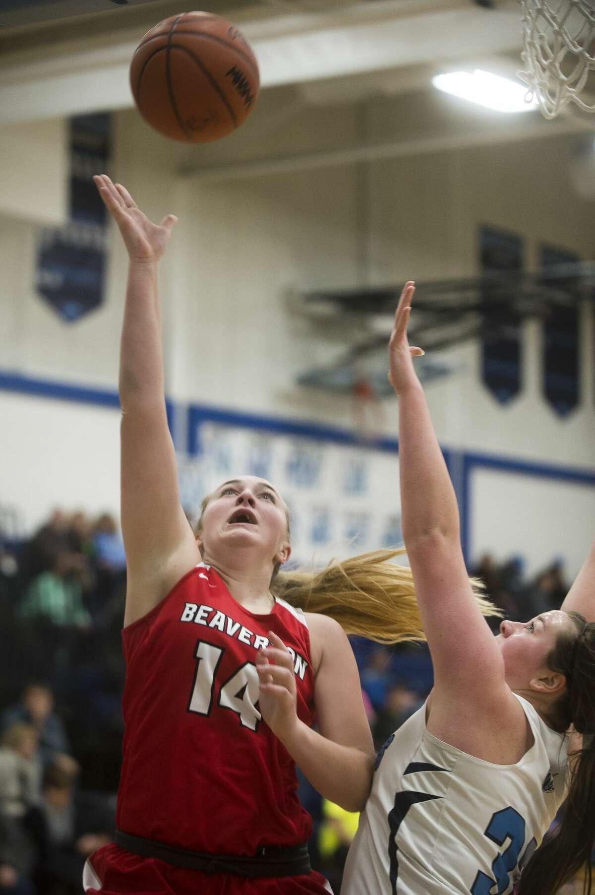 Beaverton senior Ann-Marie Hicks takes a shot during the Beavers' game against Meridian on Friday, Jan. 5, 2018 at Meridian High School. (Katy Kildee/kkildee@mdn.net)