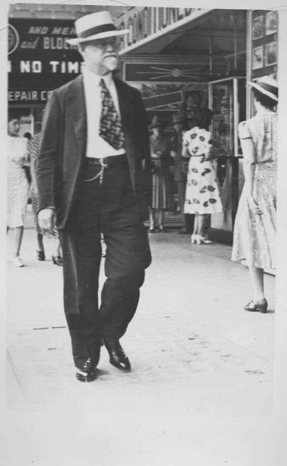 """A street photographer snaps a picture of Edward W. Heusinger, author of """"A Chronology of Events in San Antonio,"""" a classic local history reference work, in 1940 as he strolls along Houston Street. Portraits like this are sought by Urban-15 for its tricentennial video, """"Hidden Histories."""" Send photos of individuals on downtown San Antonio streets from the first half of the 20th century to George Cisneros at cisneros@dcci.com Photo: Courtesy /"""
