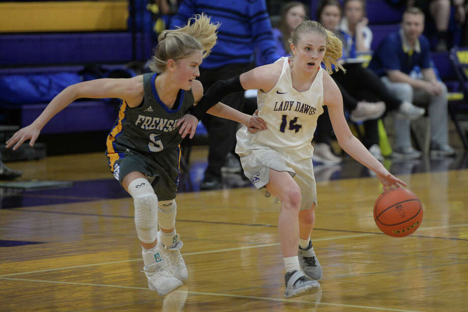 Midland High's Taysha Rushton (14) dribbles against Frenship's Maci Maddox (5) on Jan. 5, 2018, at Midland High.  James Durbin/Reporter-Telegram Photo: James Durbin