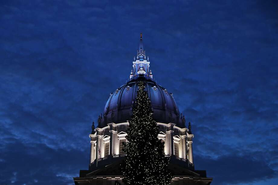 San Francisco City Hall is lit with white and blue lights on New Year's Eve. Photo: Scott Strazzante, The Chronicle