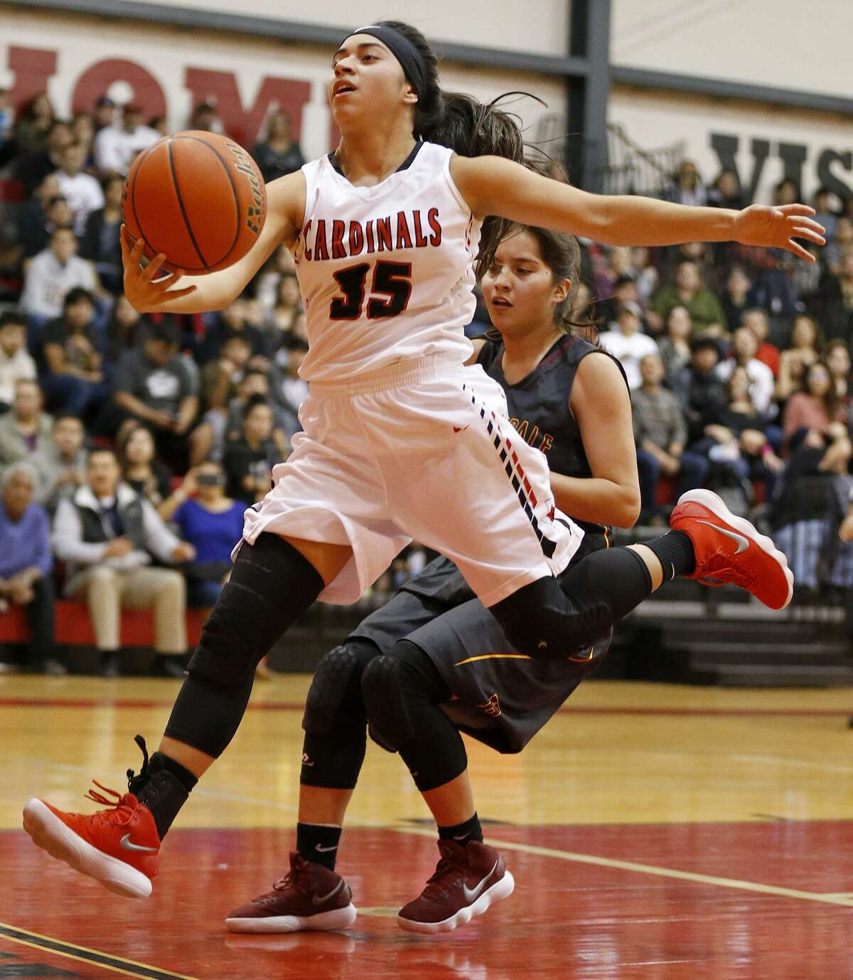 Southside's Klarissa Quintana chases after a loose ball around Harlandale's Deanna Chavarria during first half action held Friday Jan. 5, 2018 at Southside High School.
