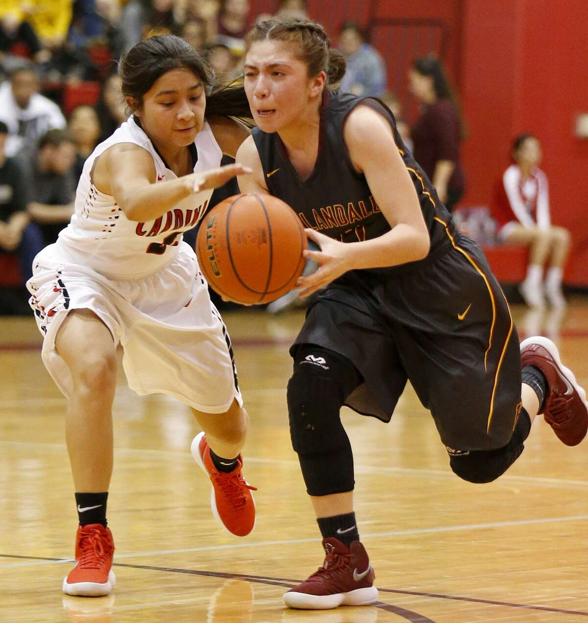 Harlandale's Serena Rodriguez drives around Southside's Marcelina Lopez during second half action held Friday Jan. 5, 2018 at Southside High School. Southside won 49-36.