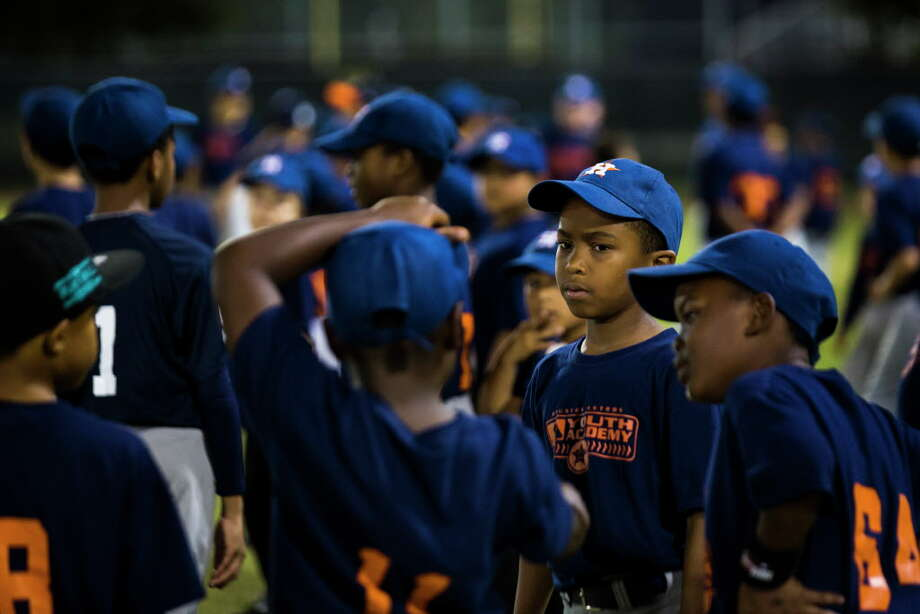 Children wait for instructions moments before warm-up sessions as part of the baseball clinics at the Houston Astros MLB Urban Youth Academy in Sylvester Turner Park, Thursday, Nov. 16, 2017, in Houston. ( Marie D. De Jesus / Houston Chronicle ) Photo: Marie D. De Jesus, Houston Chronicle / © 2017 Houston Chronicle