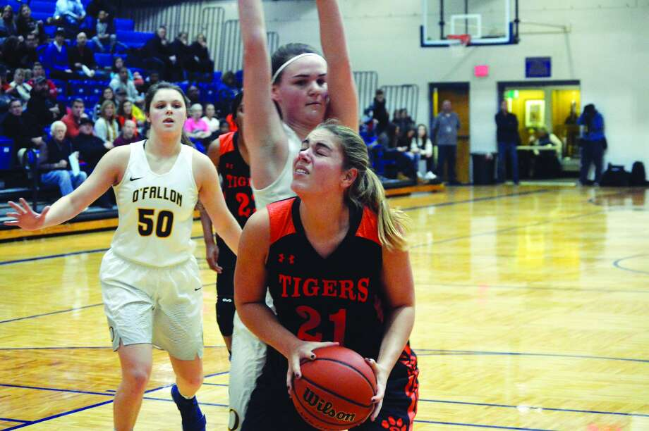 Edwardsville senior forward Rachel Pranger, front, powers up for a basket in the first quarter of Friday's Southwestern Conference road game against O'Fallon.