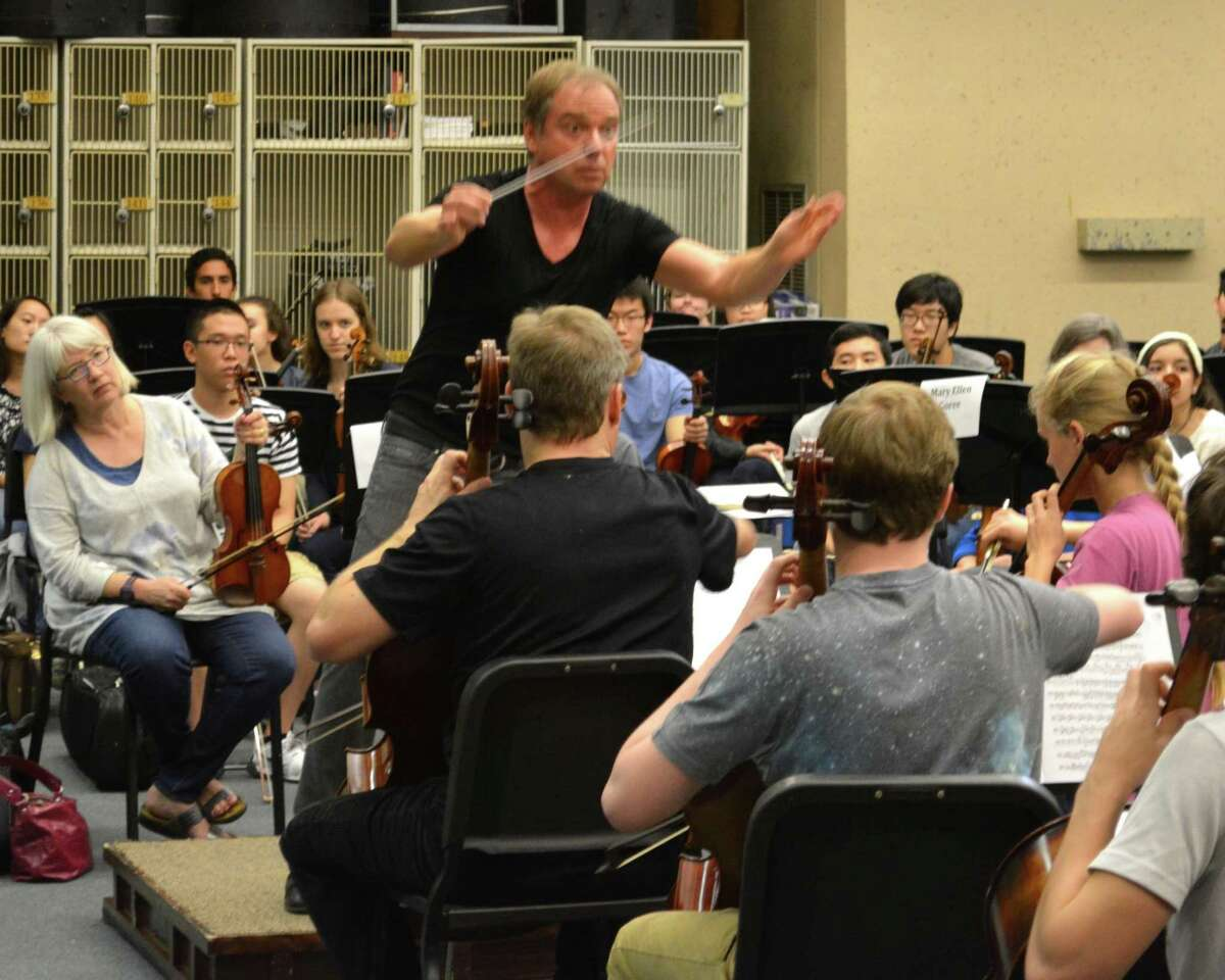 The San Antonio Symphony rehearsing in 2018 at the Tobin Center. Sebastian Lang-Lessing (pictured) brings multiple T-shirts to rehearsals so he can change into a dry one halfway through.