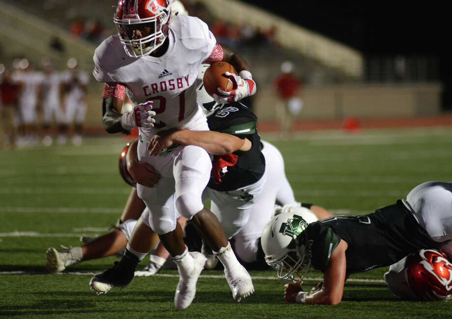 Crosby senior runnung back Craig Williams (21) pulls away from Kingwood Park junior defensive lineman Hunter Watkins on his into the end zone in the 1st quarter of their District 21-5A matchup at Turner Stadium in Humble on Oct. 6, 2017. (Photo by Jerry Baker/Freelance) Photo: Jerry Baker, Freelance / Freelance