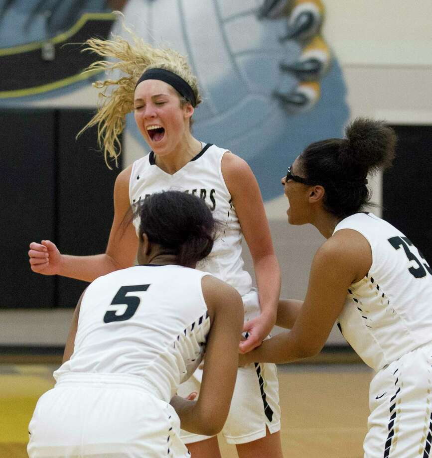 Conroe guard Riley Halloran (22) yells in celebration after her buzzer-beating three gave the Tigerettes a 49-47 win during their District 12-6A opener at Conroe High School, Friday, Jan. 5, 2018, in Conroe. Photo: Jason Fochtman, Staff Photographer / © 2017 Houston Chronicle