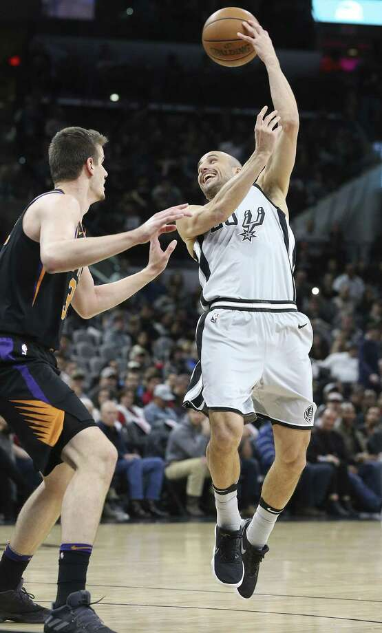 Manu Ginobili passes back over his shoulder for an asist on a three pointer as the Spurs host the Suns at the AT&T Center on January 5, 2018 Photo: Tom Reel, Staff / San Antonio Express-News / 2017 SAN ANTONIO EXPRESS-NEWS