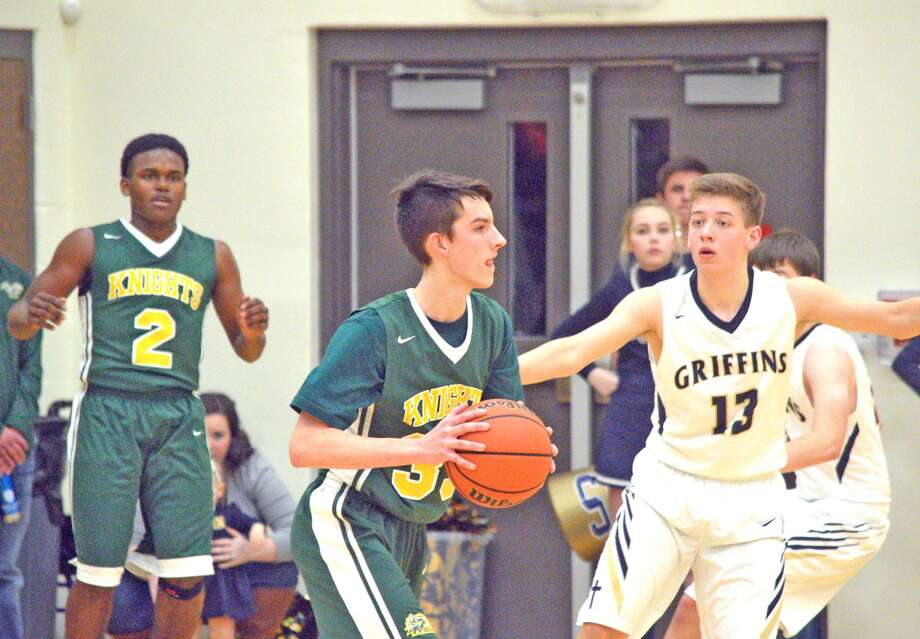 Metro-East Lutheran junior Cooper Krone, left, is guarded by Father McGivney senior Dan Jones during the fourth quarter of Friday's game at Father McGivney.