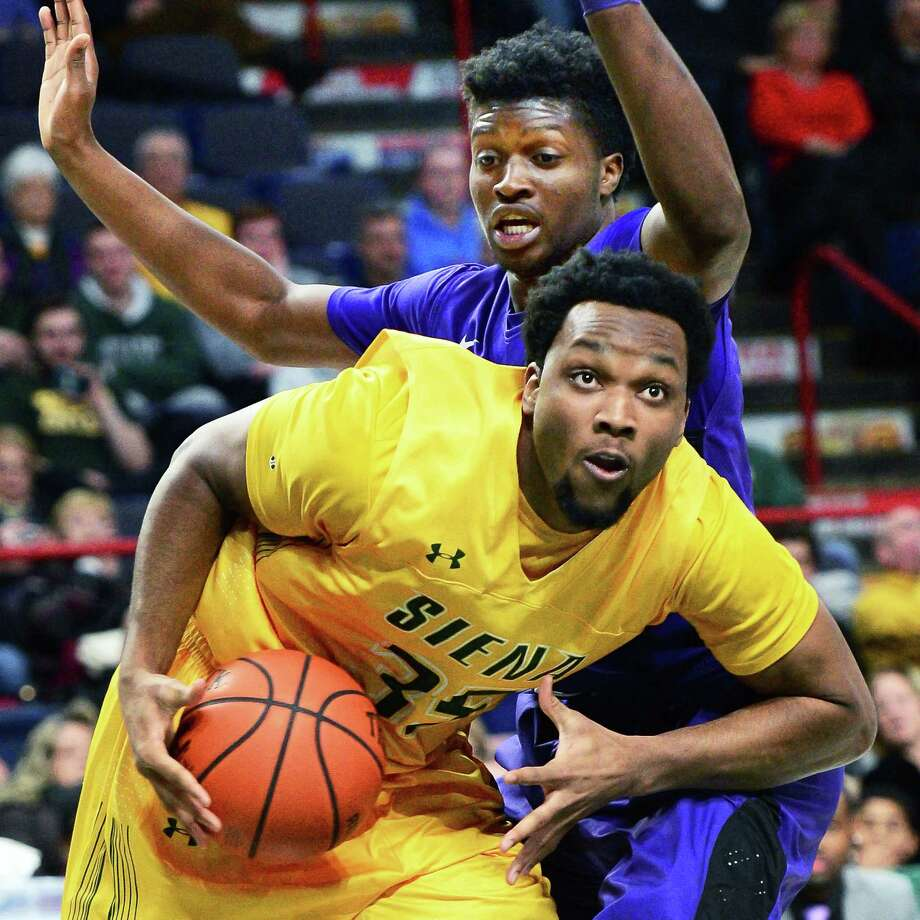 Siena's #35 Sammy Friday goes low to get around Niagara's #10 Kahlil Dukes battle during their MAAC game at the Times Union Center Friday Jan. 5, 2018 in Albany, NY.  (John Carl D'Annibale / Times Union) Photo: John Carl D'Annibale / 20042245A