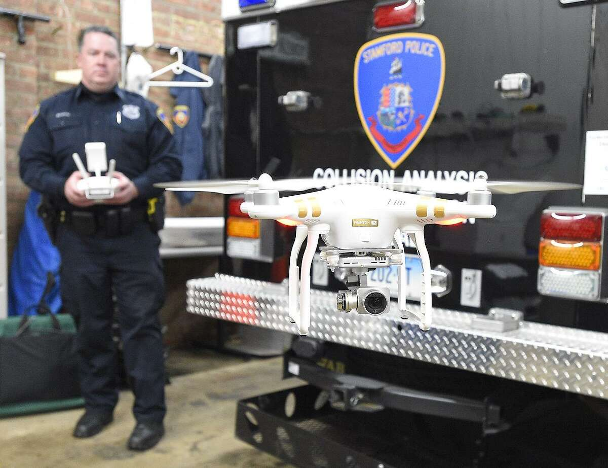 Stamford Police Officer Jeff Booth flies a DJI Phontom III drone used by the Collision Analysis Reconstruction Squad (CARS) at their field office in Stamford, Conn. on Thursday, Jan. 4, 2018. Booth is currently one of four officers FAA certified, with several other officers being trained.