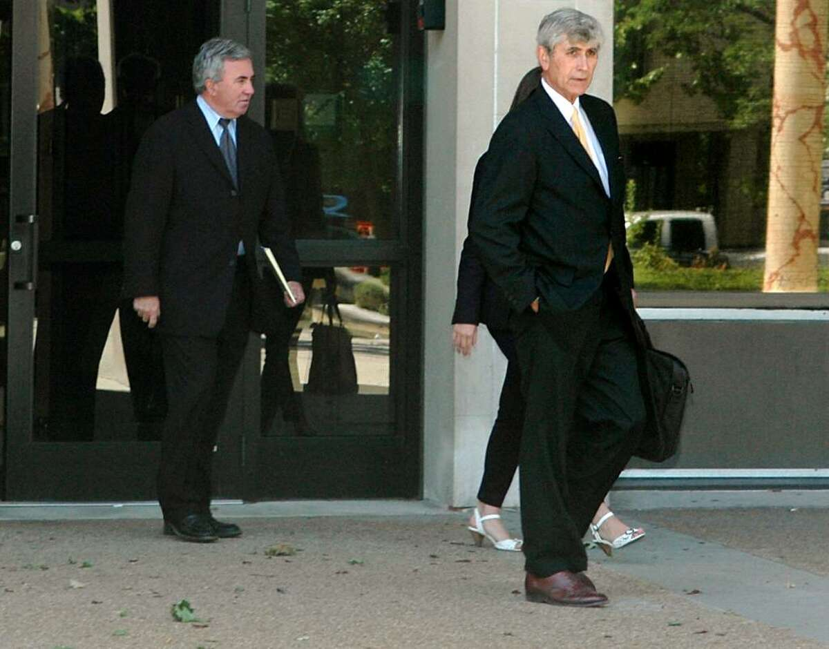 Michael (Mickey) Sherman leaves the Federal Courthouse in Bridgeport with his defense attorney, William Dow III on Wednesday June 30, 2010. Sherman of Greenwich pleaded guilty to two misdemeanor charges of willfully failing to pay taxes on returns he filed in 2001 and 2002. While Sherman has paid about $397,000 in taxes, he still owes about $1.1 million in additional taxes, interests and penalties from other years.
