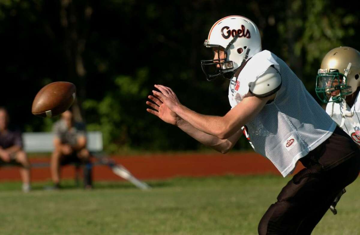 Shelton's Ray Pendagast receives the snap, during practice for the New Haven County team at Wilbur Cross High School in New Haven, Conn. on Wednesday June 30, 2010.