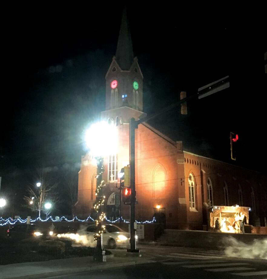 Still inside the window of the 12 days of Christmas, which ends today, St. Boniface Catholic Church in downtown Edwardsville is showing off its holiday colors with red and green backlit clocks on the steeple. Photo: Bill Craft • For The Intelligencer