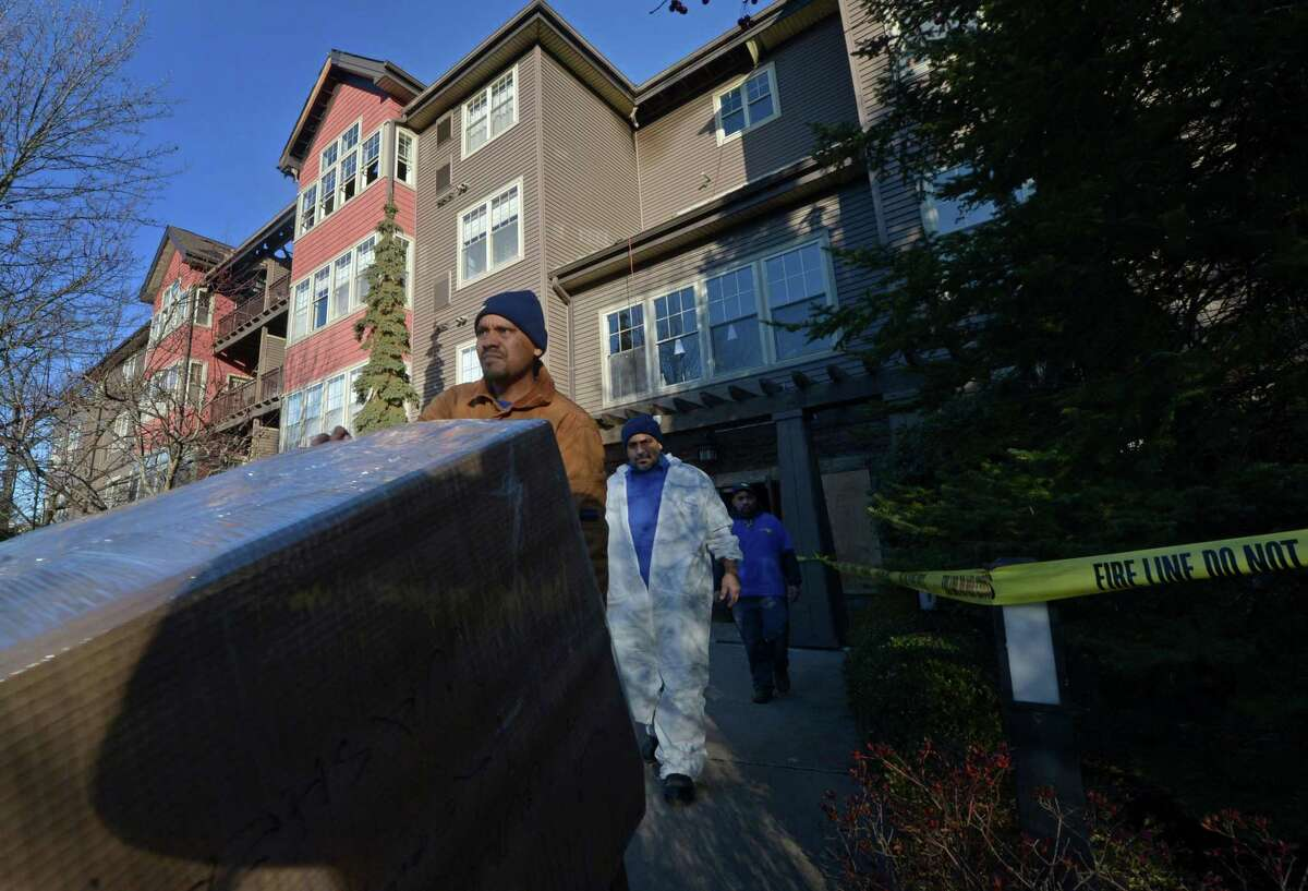 Workers with Servicemaster move out belongings at the StoneWood Condominiums on Richard Avenue Thursday, Nov. 21, 2017, following the devastating fire there Dec. 11.