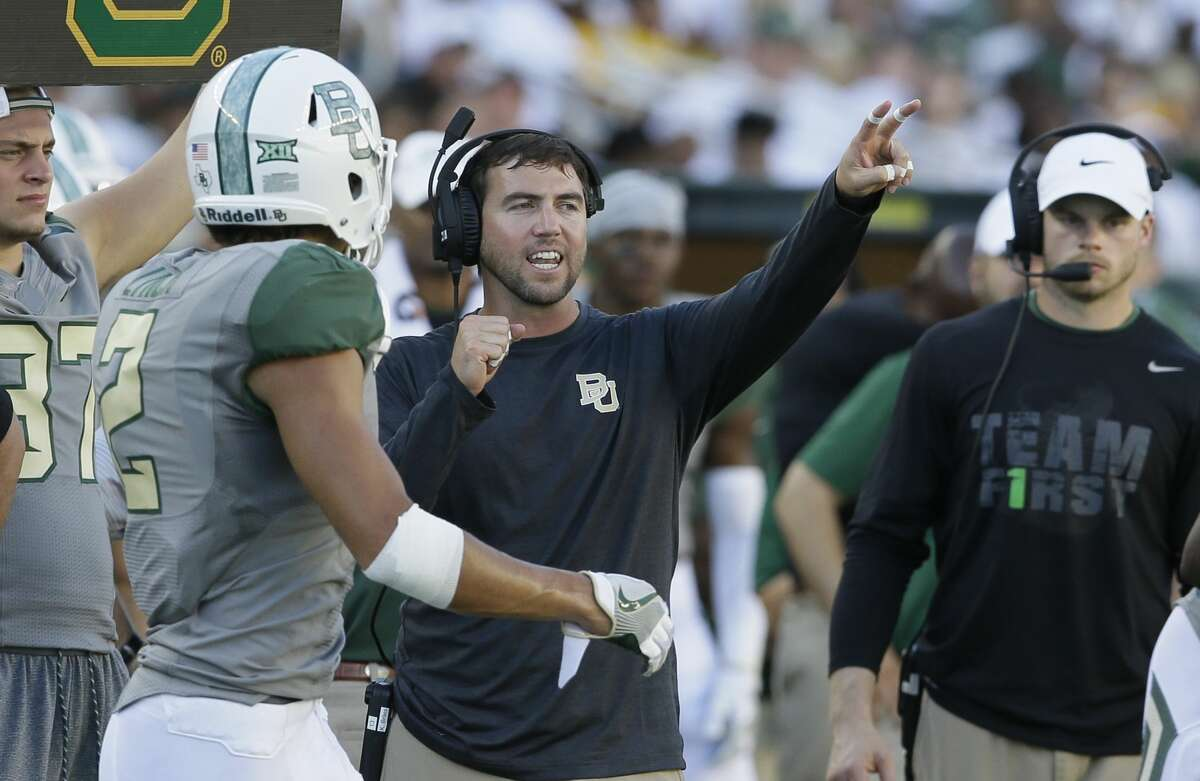 Baylor offensive coordinator Kendal Briles gives direction during the second half of an NCAA college football game against SMU Saturday, Sept. 10, 2016, in Waco, Texas. Baylor won 40-13. (AP Photo/LM Otero)