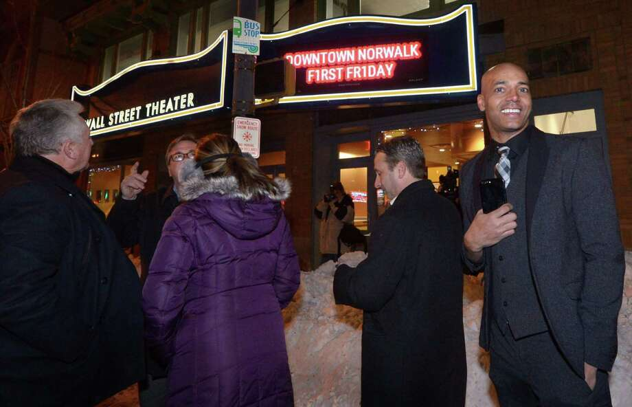 Norwalk Mayor Harry Rilling, Wall Street Theater Developer Frank Farricker, Lucia Rilling and State Senate Majority Leader Bob Duff join Theater Co. Artistic Director Billy Blank Jr. to light new marquee sign outside renovated theater at 71 Wall St. during a reception Friday, January 5, 2018, in Norwalk, Conn. Photo: Erik Trautmann / Hearst Connecticut Media / Norwalk Hour