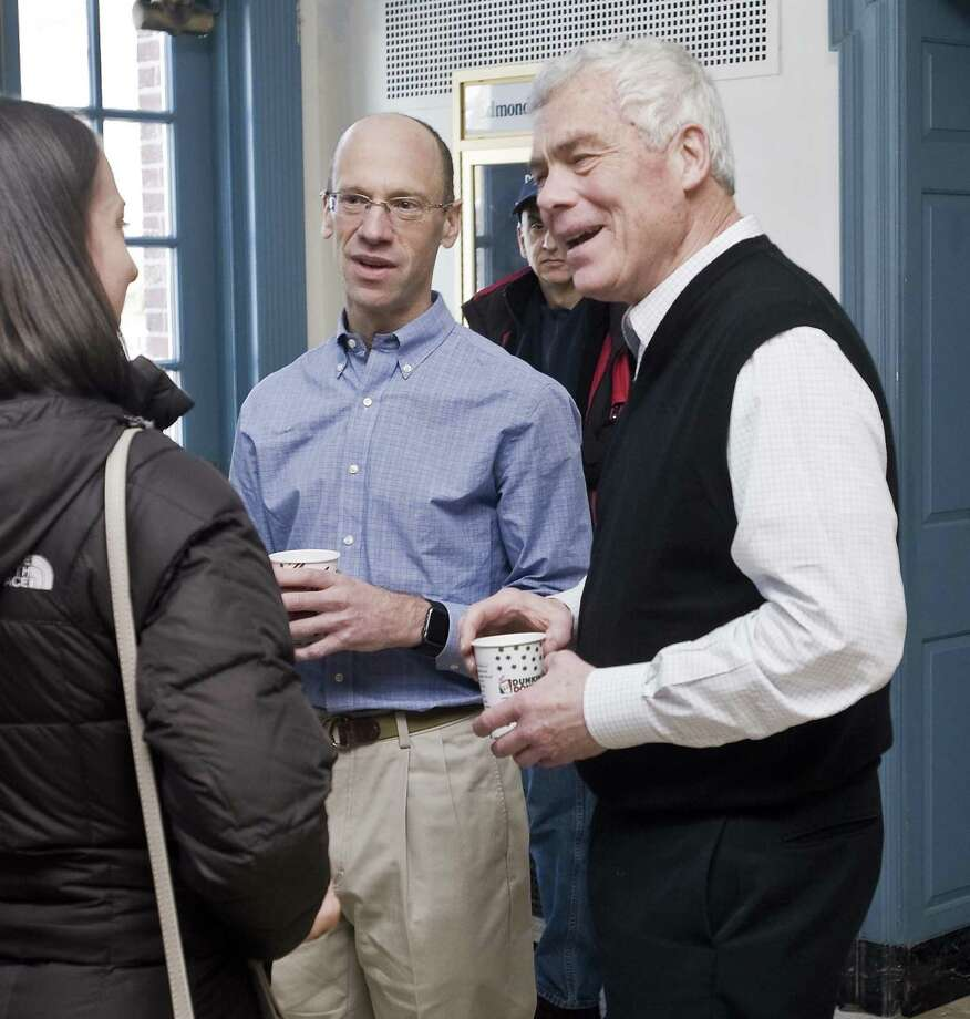 Monte Frank and Oz Griebel, a team running on the Independent ticket for Lieutenant Governor and Governor, chat with folks attending their Press Conference at Edmond Town Hall in Newtown. Saturday, Jan. 6, 2018 Photo: Scott Mullin / For Hearst Connecticut Media / The News-Times Freelance