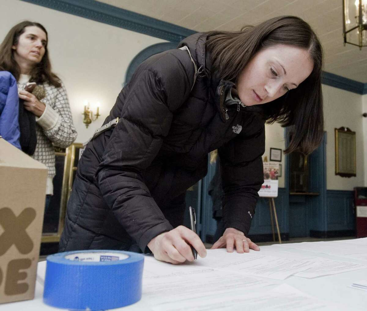 Andrea Myers, of Danbury, looks over a petition at Edmond Town Hall in Newtown, to get the team of Oz Griebel and Monte Frank on the ballet for Governor and Lieutenant Governor. Saturday, Jan. 6, 2018
