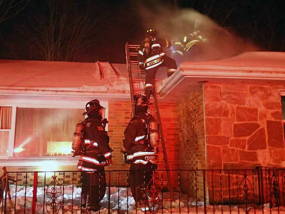 The Easton Volunteer Fire Department required reinforcements from surrounding towns as it fought to extinguish a basement fire on the evening of Jan. 5, 2018. Photo: Contributed Photo / Fairfield Fire Department / Contributed Photo / Connecticut Post Contributed