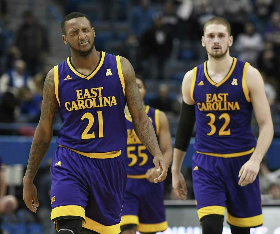East Carolina's B.J. Tyson, left, reacts after missing a chance to tie the game with a 3-pointer the final seconds Saturday in Hartford. Photo: Jessica Hill / Associated Press / AP2018