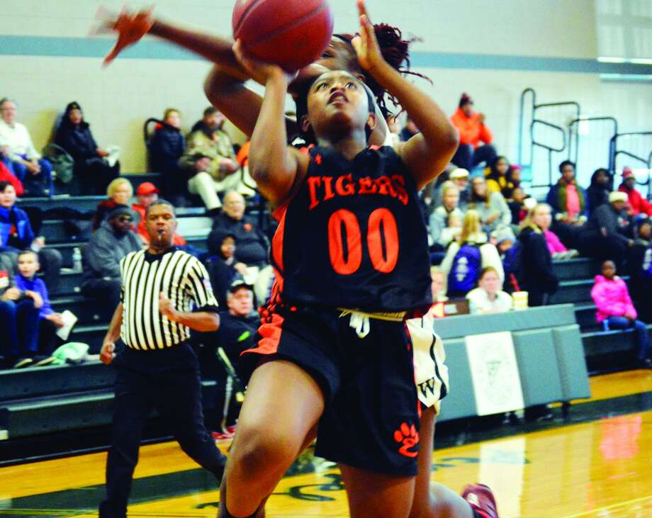 Edwardsville sophomore point guard Quierra Love goes up for a lay-in after getting a steal during the third quarter of Saturday's game against Whitfield at the St. Joseph's Shootout.