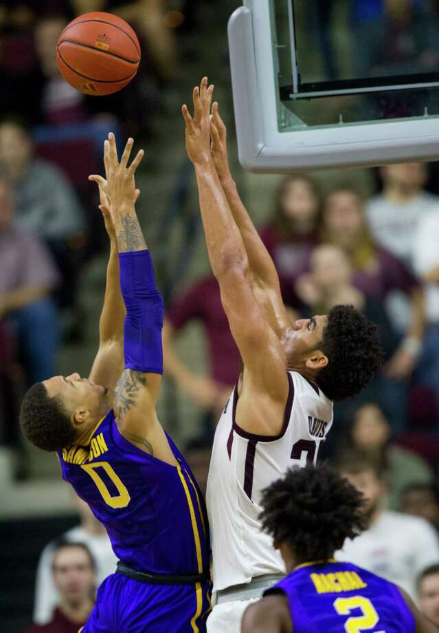 LSU guard Brandon Sampson (0) shoots over Texas A&M center Tyler Davis (34) during the first half of an NCAA college basketball game, Saturday, Jan. 6, 2018, in College Station, Texas. (AP Photo/Sam Craft) Photo: Sam Craft, Associated Press / AP