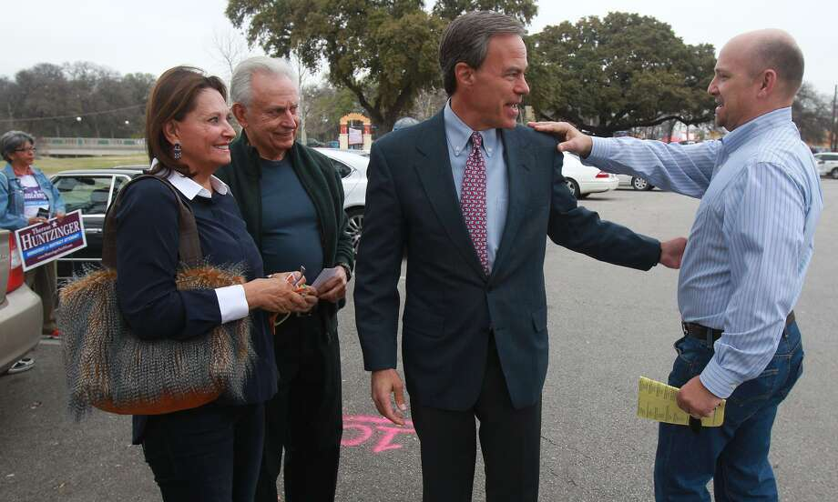 Joe Straus (center), Speaker of the Texas House of Representatives, talks with Jorge Canseco (right) at Lions Field Park on the last day of early voting in the March 2014, the last gubernatorial election. Standing on the left are Jan and Bob Marbut. This year, Texas is again at the forefront of primary races in the nation, with election set for March 6. Early voting starts Feb. 20. Photo: John Davenport / San Antonio Express-News / ©San Antonio Express-News