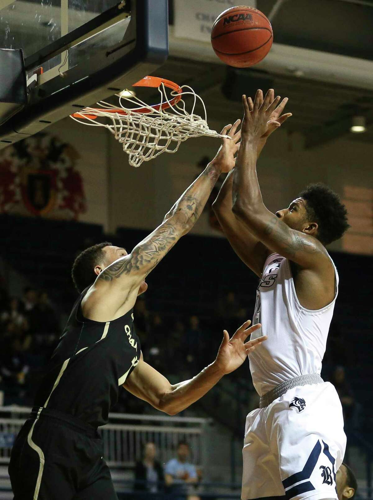 Rice Owls guard Bishop Mency (15) beats Charlotte 49ers forward Najee Garvin (1) to put the ball into the basket during the first quarter of the NCAA game at Tudor Field House on Saturday, Jan. 6, 2018, in Houston.