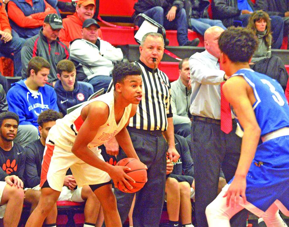 Edwardsville junior Malik Robinson looks to pass the ball during the second quarter of Saturday's game against Kansas City Rockhurst at the 27th annual Highland Optimist/Scott Credit Union Shootout.