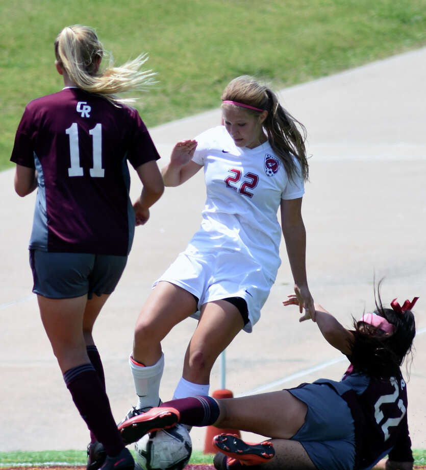 Tompkins freshman forward Skylar Parker, center, battles for the ball with Cinco Ranch sophomore defender Makayla Wang (22) as Cougar senior defender backs up the play during the 2nd half of their Girls Region III-6A Soccer Final at Abshier Stadium in Deer Park on Saturday, April 8, 2017. (Photo by Jerry Baker/Freelance) Photo: Jerry Baker, Freelance / Freelance