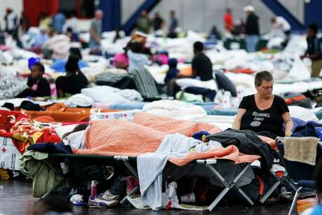 Mary Colson sits on a cot at the George R. Brown Convention Center where nearly 10,000 people are taking shelter after Tropical Storm Harvey Wednesday, Aug. 30, 2017 in Houston. ( Michael Ciaglo / Houston Chronicle)